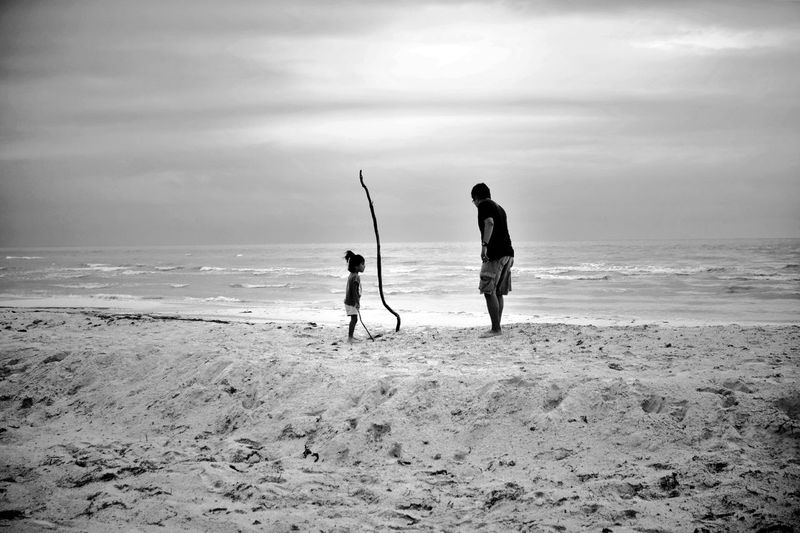 Farther And Daughter At Beach