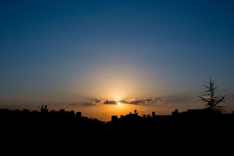 city sunset cloudscapes Built Structure Non-urban Scene Tree Environment Landscape Outdoors Clear Sky Idyllic No People Sun Nature Tranquil Scene Orange Color Tranquility Scenics - Nature Beauty In Nature Copy Space Sunset Silhouette Sky Panorama Panoramic EyeEmNewHere