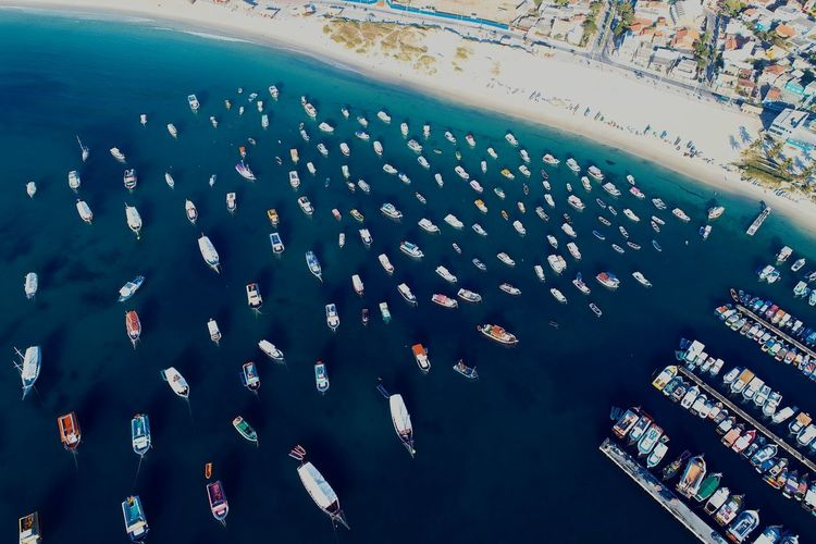 Aerial View Of Boats Moored In Sea