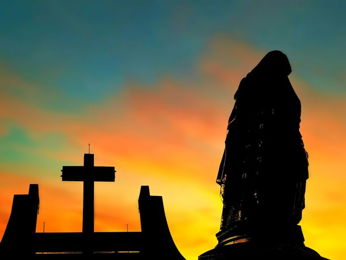 Silhouette of the large Saint Ann statue and cross on church with blurred sunrise sky background on architecture design and art of religion concept Religion Catholic Chruch Cross Saint Ann Blurred Background Outdoors Low Angle View Faith Architecture Colorful Shadow Twilight Backside Sunrise Morning Evening EyeEm Selects Sunset Silhouette Spirituality Cross Sky Architecture Memorial Sculpture Historic Statue Crucifix Jesus Christ