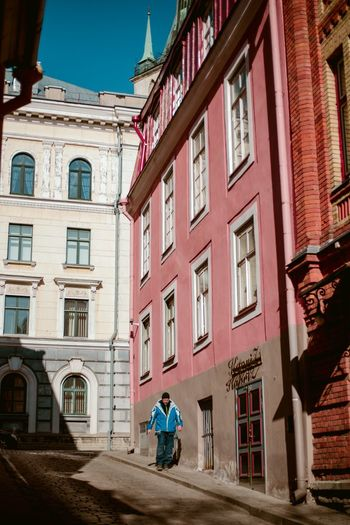 Tallinn streets People In Motion Real People Architecture And People Street Photography City Life Cities Building Exterior Architecture Built Structure Window Building City Day Residential District Street Outdoors Façade Sunny Streetwise Photography