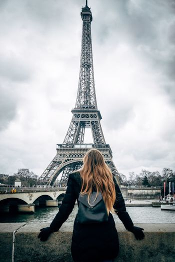 Female Explore Travel Eiffel Tower Paris Architecture Built Structure Travel Destinations Tourism City Tower Cloud - Sky Travel Tall - High Sky One Person Lifestyles Real People Women Outdoors Leisure Activity Rear View