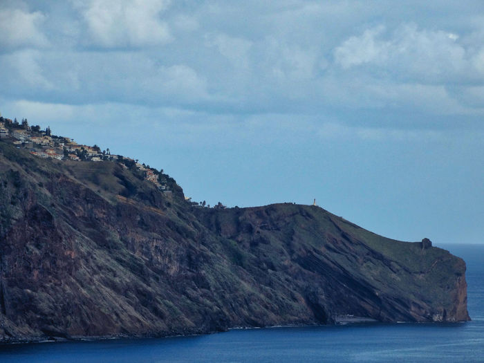 Scene with land and sea. Sky Cloud - Sky Water Sea Mountain Beauty In Nature Nature Tranquility Scenery Rock Scenics - Nature Tranquil Scene Environment Waterfront Day Land No People Horizon Outdoors Formation View Into Land Mountain Peak Rocky Coastline Madeira