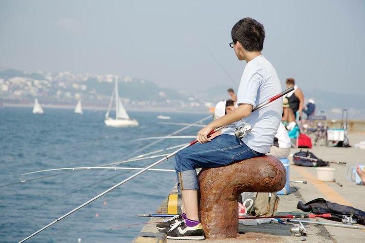 Snapshot Boy Fishing Summer Sea
