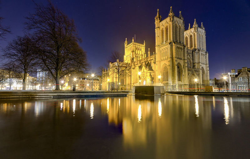 Bristol Cathedral, Bristol, United Kingdom Bristol Cathedral Architecture Belief Building Building Exterior Built Structure England History Illuminated Night No People Place Of Worship Reflection Religion Sky Spirituality Travel Destinations Tree Water Waterfront