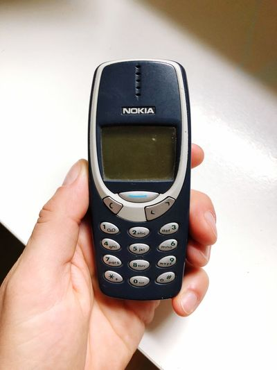 Good old times - Nokia 3310 Retro Nostalgia Mobile Phone 3310 Nokia3310 Nokia  EyeEm Selects Human Hand Hand Human Body Part Holding Technology Close-up Indoors  Finger Human Finger Wireless Technology Communication