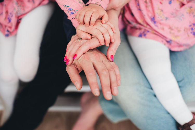 Family hands of four, mother, father and 2 kids. high quality photo
