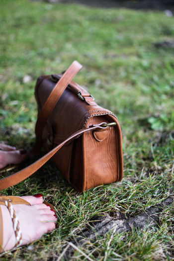 Close-Up Of Leather Bag On Grass