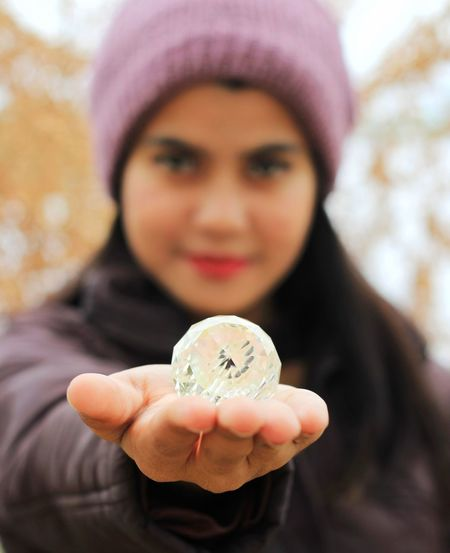 Holding One Person Portrait Looking At Camera Front View Showing Focus On Foreground Finance Headshot Adult Wealth Close-up Business Clothing Emotion Currency Coin Women Hand Warm Clothing