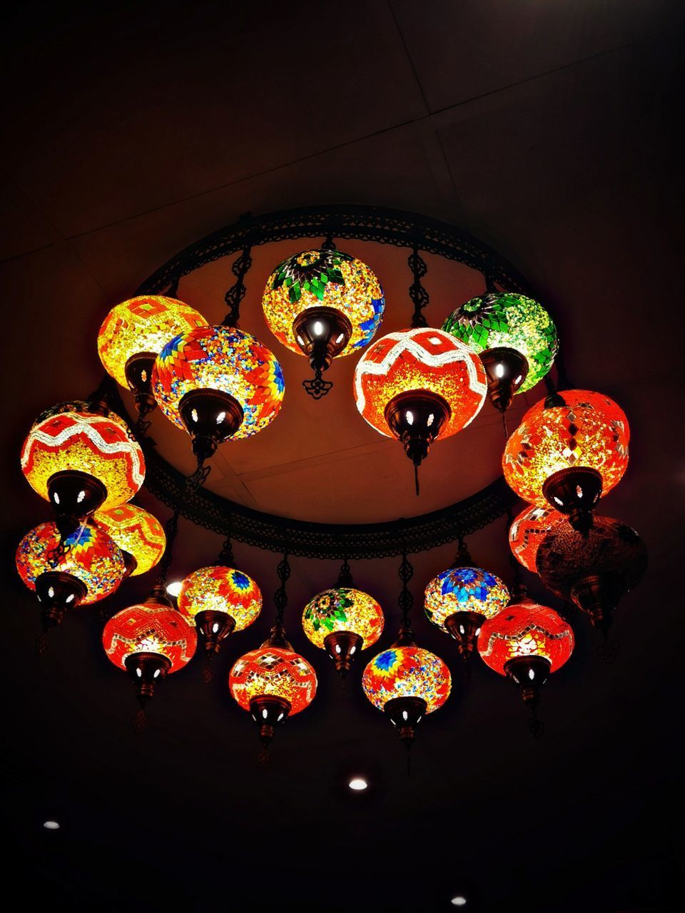 LOW ANGLE VIEW OF ILLUMINATED LANTERNS