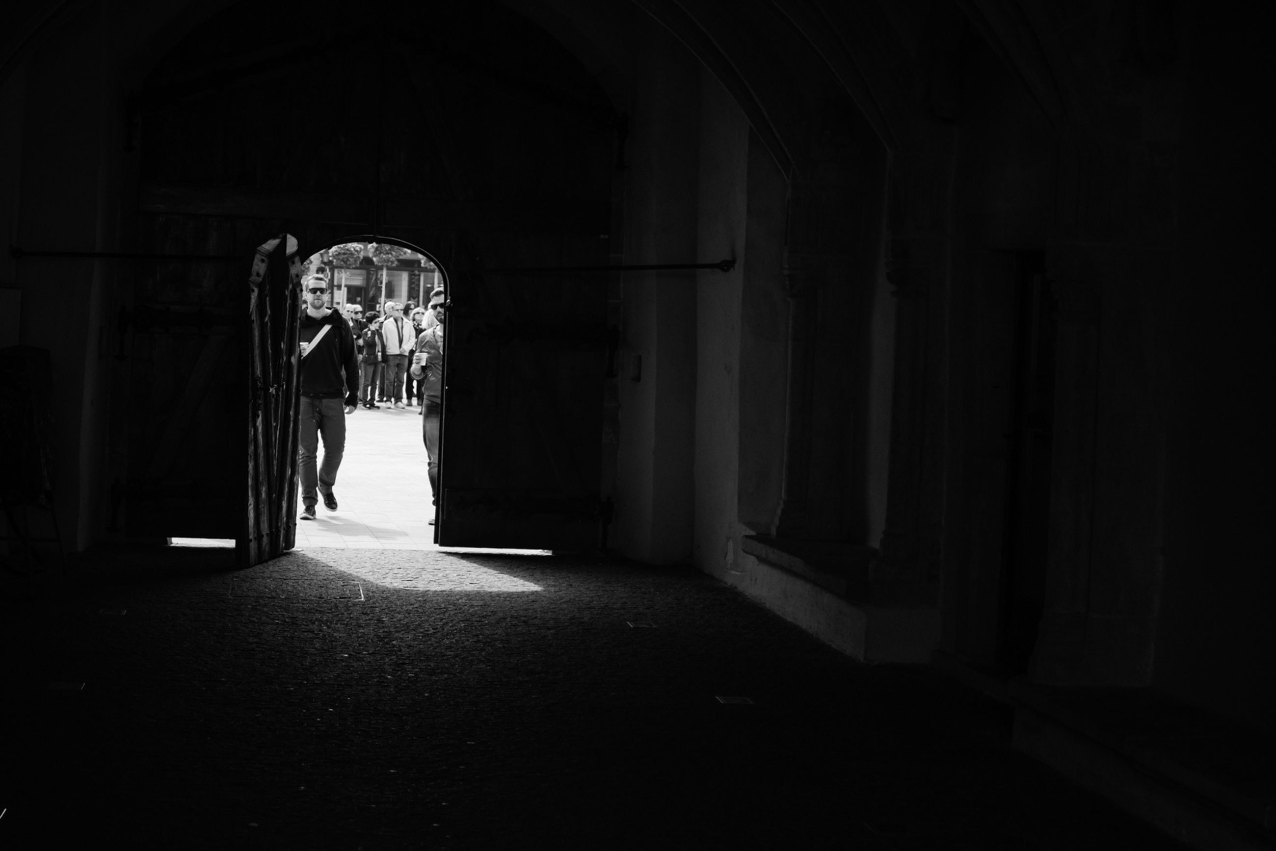 architecture, indoors, built structure, arch, corridor, the way forward, entrance, door, building exterior, architectural column, night, building, empty, place of worship, illuminated, doorway, history, flooring, spirituality