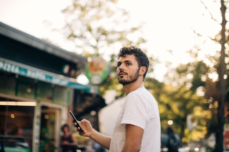 Full length of young man using smart phone