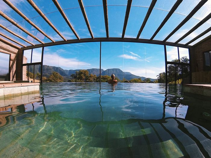 Reflection of man in swimming pool