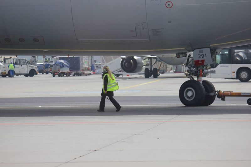 At the runway Service Fraport Runway Airplane View Airplane Shot AirPlane ✈ Women Transportation Mode Of Transportation Air Vehicle Airplane Full Length Real People Occupation Travel Airport Men Safety Reflective Clothing Day People Airport Runway Airplane Mechanic Working Protection Clothing Aerospace Industry