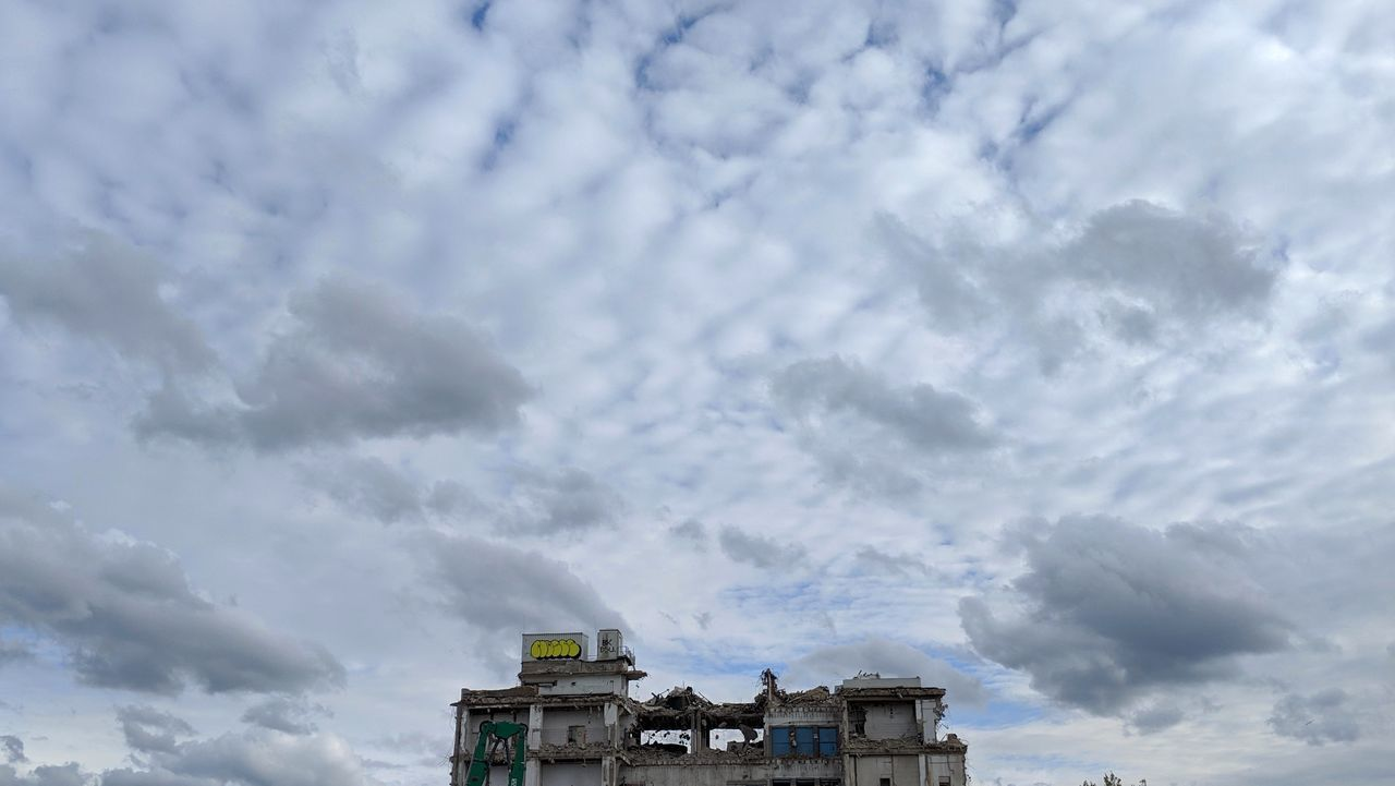 cloud - sky, sky, built structure, architecture, building exterior, low angle view, nature, no people, day, building, outdoors, overcast, high section, transportation, communication, white color, storm, mode of transportation, history
