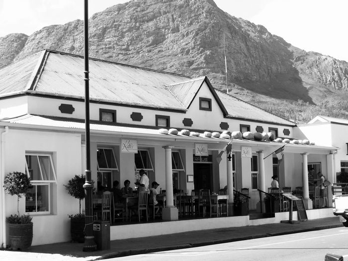 A sunny day on the verandah Architecture Black And White Building Exterior Built Structure Day Exterior Façade Franschhoek House Mountain No People Outdoors Pumpkins Restaurant Rooftop Town Tranquil Scene Verandah