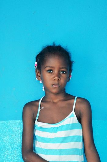 Blue Child Childhood Close-up Day Front View Human Body Part Looking At Camera One Person People Portrait Real People Studio Shot The Portraitist - 2018 EyeEm Awards Offspring Girls Women Sadness Emotion Looking At Camera Colored Background Females Cute Indoors  Serious Body Part Innocence Depression - Sadness Turquoise Colored The Portraitist - 2018 EyeEm Awards
