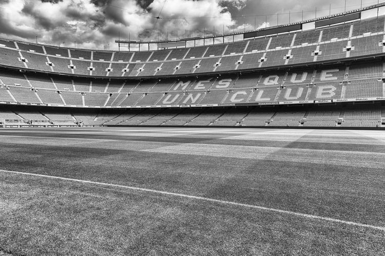 BARCELONA - AUGUST 11: Interior view of Camp Nou stadium, home of Barcelona Football Club, Catalonia, Spain, on August 11, 2017. With a seating capacity of 99,354 it is the largest stadium in Europe Built Structure Architecture Stadium Sport Day Sky Empty Building Exterior No People Nature Cloud - Sky Outdoors Absence Curve Soccer Team Sport Sunlight Low Angle View Soccer Field Competition