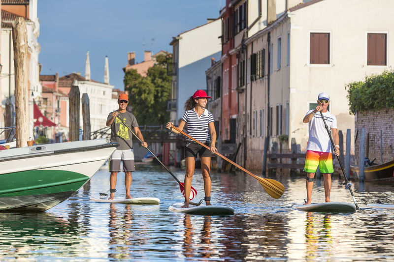 Standup paddling in the canals of Venice, Italy Activity Canal Canale Grande Canals Enjoy Exploring Group Holiday Leisure Outdoors Sightseeing Sports Standup Standup Paddleboarding Standup Paddling Sup Surf Surfing Togetherness Tour Tourism Venedig Veneto Venice Water