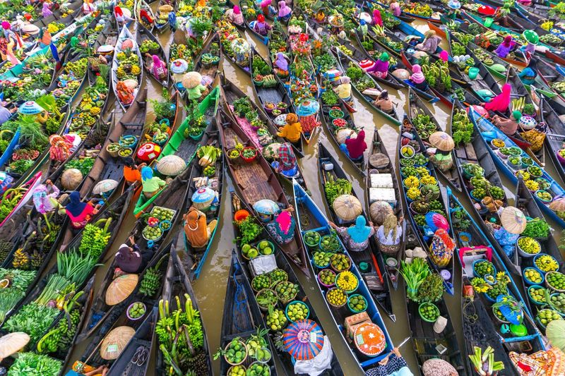 High Angle View Of Vendors In Boat On Floating Market