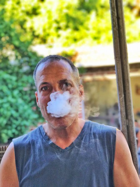 Looking At Camera Portrait Headshot One Person Front View Real People Mature Adult Focus On Foreground Casual Clothing Lifestyles Leisure Activity Mature Men Day Close-up Standing Tree Outdoors One Man Only People Adults Only VapeLife Vapecommunity Vapersofamerica