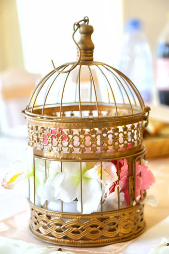 Wedding floral decoration arrangement in vintage birdcage. Close-up Birdcage Arrangement Background Bird Beautiful Blooming Blossom Bouquet Bridal Cage Communion Concept Decoration Delicate Gardening Gift Idea Love Nature Party Romantic Pink White Rustic Vintage Spring Symbol Locked Petal