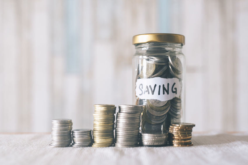 money jar with coins on table , saving concept Economy Planning Thrifty Banking Budget Cash Coin Collect Concept Currency Day Earnings Finance Finance And Economy Financial Future Growth Income Investment Jar Money Pension Retirement Savings Wealth