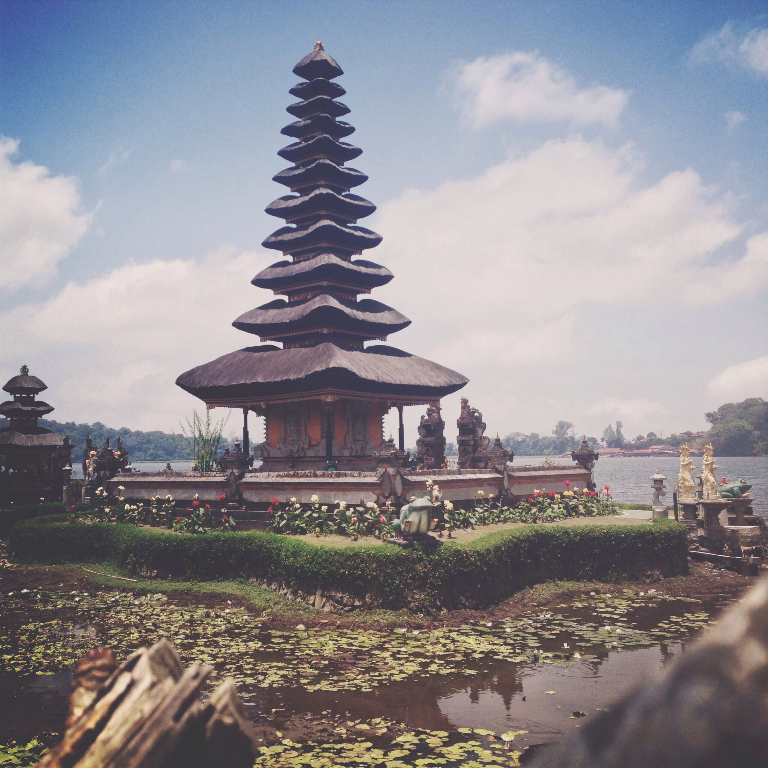 built structure, architecture, sky, religion, building exterior, place of worship, spirituality, cloud - sky, temple - building, water, tree, tranquility, cloud, nature, travel destinations, day, outdoors, no people, famous place