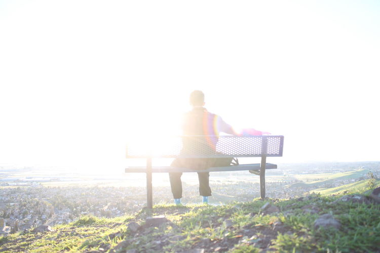 Bench Clear Sky Into The Light Landscape Lens Flare Mile High Real People Rear View Scenics Sun Sunbeam Tranquil Scene Tranquility