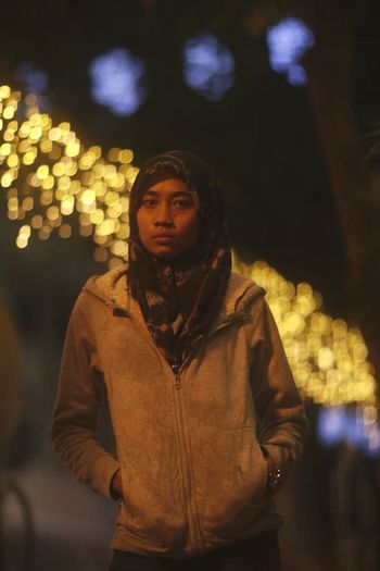 Streetphotography Midnight Malaysia Memorys  Bokeh Starburst Bulb EyeEm Ready   One Person Night Waist Up People Adult Adults Only Front View Casual Clothing Outdoors Illuminated City EyeEmNewHere Fashion Stories The Graphic City