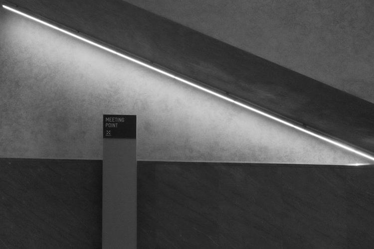 High angle view of sign on wall