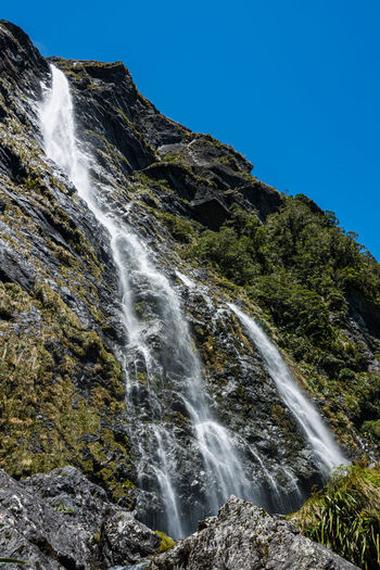 Low angle view of earland falls waterfall against clear sky