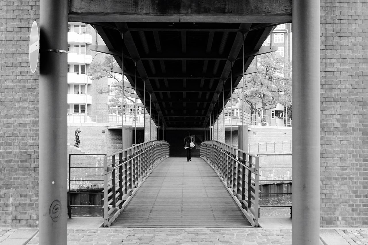 architecture, built structure, bridge - man made structure, connection, day, architectural column, the way forward, real people, below, two people, men, indoors, building exterior, under, people