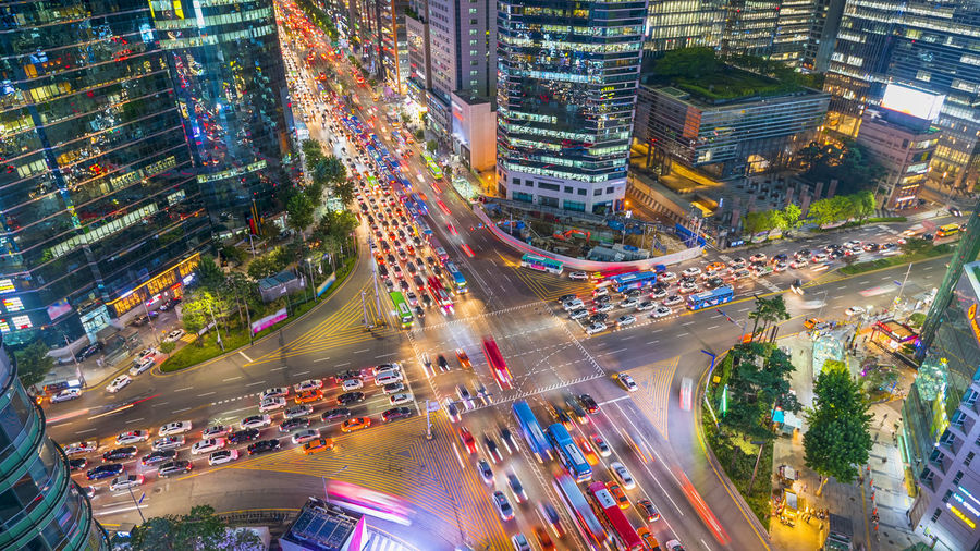 Aerial view of illuminated city street at night