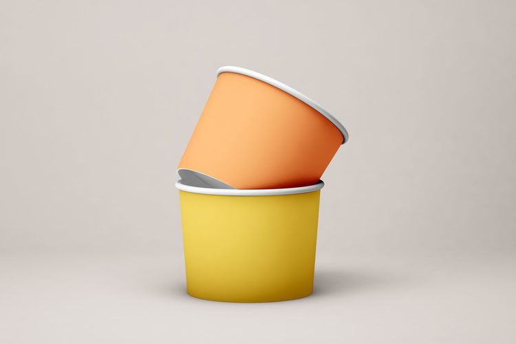 Close-up of yellow lamp over white background