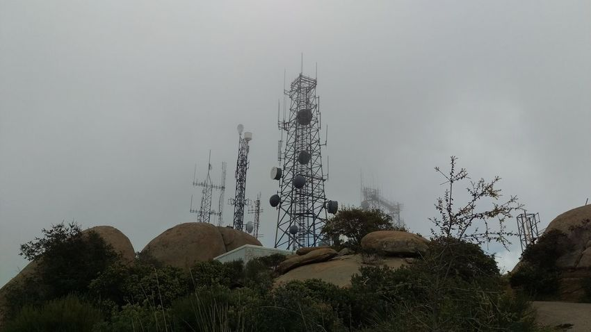 Architecture Broadcasting Built Structure Communication Connection Fog Global Communications Land Mountain Nature No People Outdoors Plant Radio Wave Satellite Satellite Dish Sky Technology Tower Tree