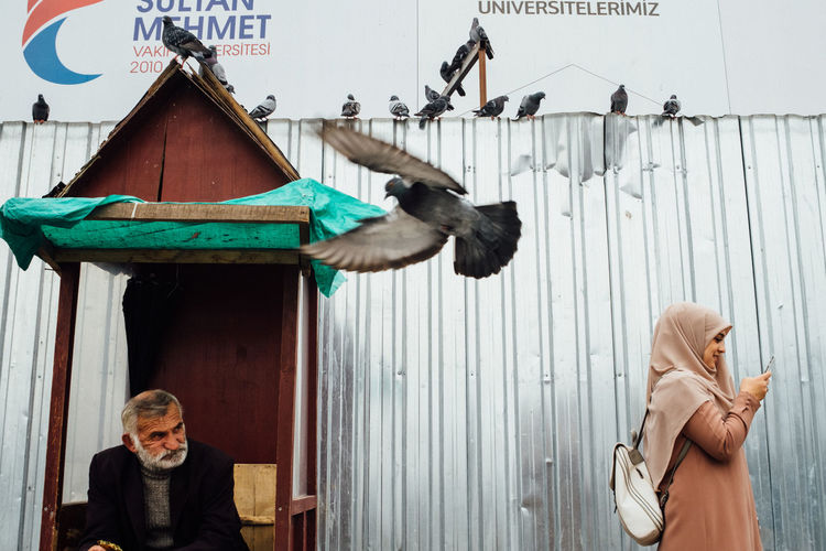 Portrait of man feeding birds