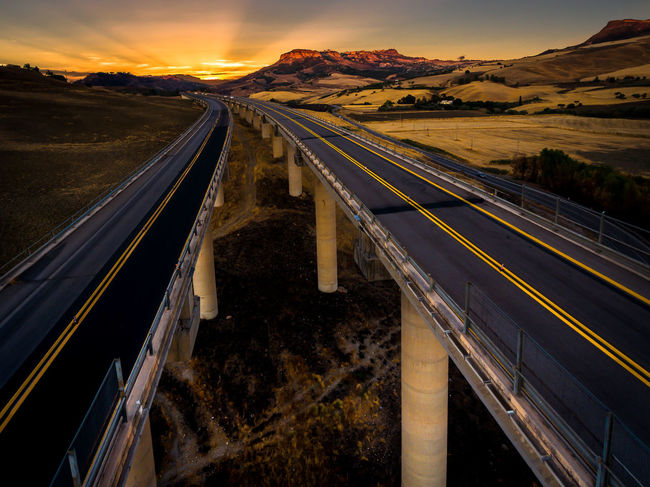 Sicily Sunset_collection Architecture Bridge - Man Made Structure Day Highway Landscape Mountain Nature No People Outdoors Road Scenics Sky Sunset Transportation Viaduct