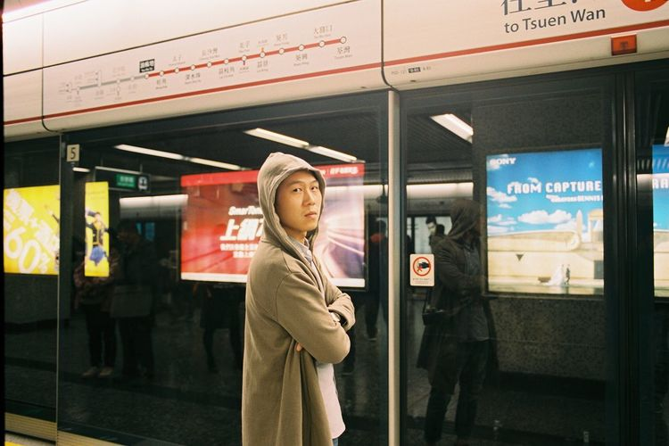 Woman standing in bus