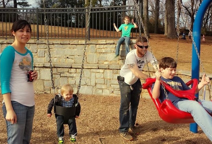 Hard working father having fun with his family at the park Family Father Mother Three Sons Father Playing With Fam First Eyeem Photo Happiness Horizontal Outdoors Outside Park Play Playground Shorty Howell Park Swing Swings Time To Play  Working Father