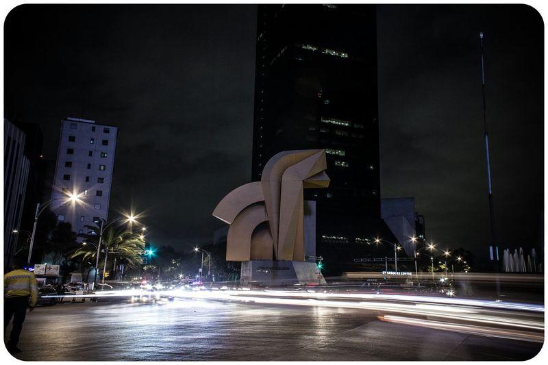 Illuminated street light against sky at night