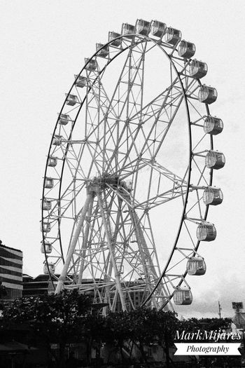 Amusement Park Amusement Park Ride Architecture Arts Culture And Entertainment Big Wheel Building Exterior Built Structure Clear Sky Day Ferris Wheel Low Angle View No People Outdoors Sky