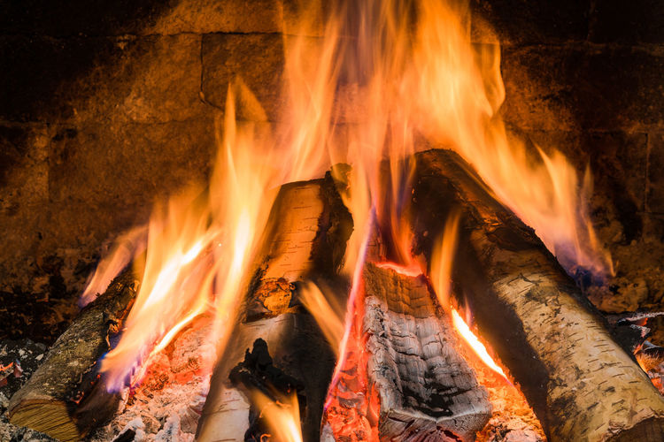 Logs burning in fireplace. Blaze Bonfire Winter Wood Ash Burn Burning Close-up Fire Fireplace Flame Heat - Temperature Logs Logs For The Fire No People Nobody Outdoors Spark Warm Warmth
