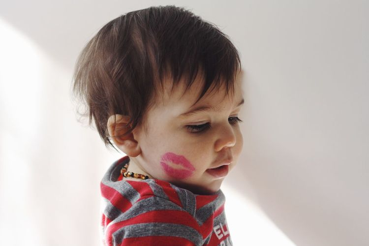 Portrait Of Toddler With Lipstick Kiss