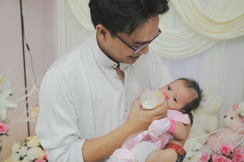 Close-Up Of Father Feeding Daughter