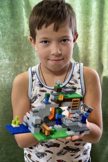 Portrait of boy holding toy