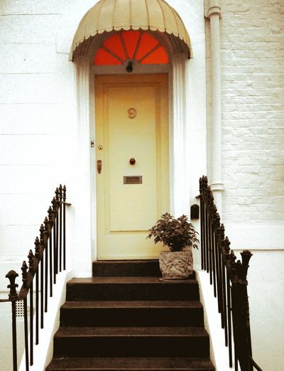 Yellow door of Notting hill Staircase Steps Steps And Staircases Railing Architecture Built Structure No People Day Indoors  London Notting Hill Architecture Entry Yellow Doorway Arch Safety Entrance Door Closed Building Exterior City Travel Destinations