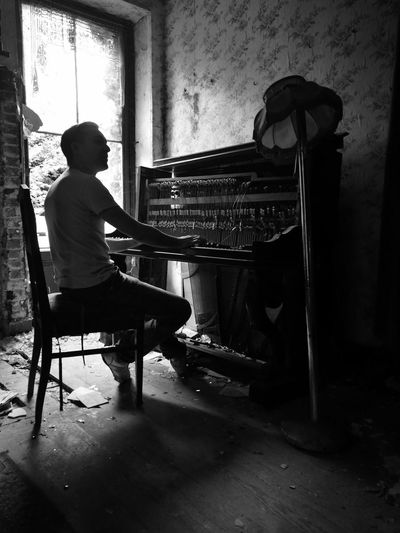 Piano Music One Man Only Indoors  One Person Adults Only Musical Instrument Musician Adult Sitting Urbex Desolate Scene Desolatecollection Urbexphotography Abandoned Urbex Abandoned Abandoned Places Built Structure Indoors  Manoir Aux Statues