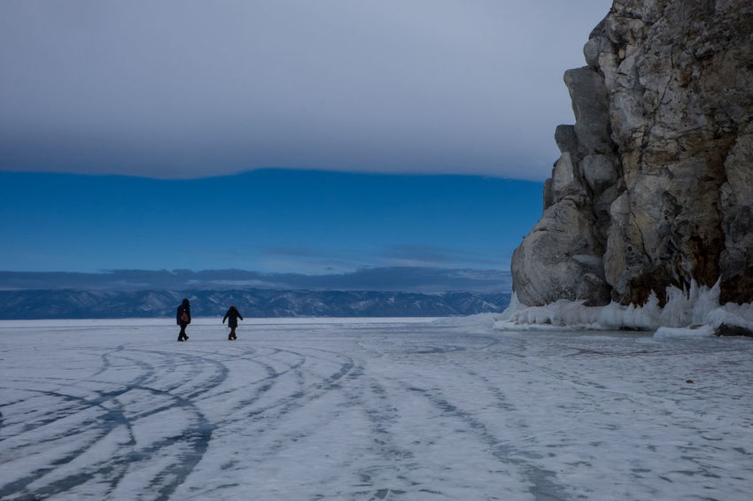 Walking on frozen lake Adventure Beauty In Nature Cold Temperature Frozen Frozen Lake Surface Frozen Lake, Landscape Lifestyles Nature Outdoors Real People Sky Snow Weather Winter