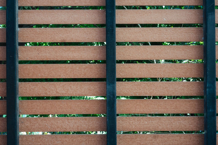 No People Day Full Frame Pattern Backgrounds Wood - Material Brown Nature Outdoors Architecture Metal Textured  In A Row Grass Wall - Building Feature Built Structure Sunlight Close-up Green Color Wood